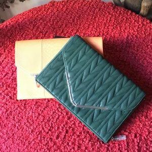 Two brand NEW! BCBG Maxazria envelope clutches.